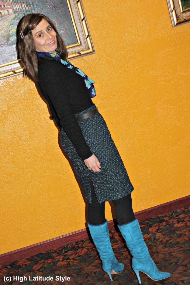 stylist in tweed skirt with turquoise boots