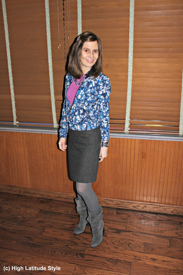 #fashionover40 woman in work outfit with tweed skirt and floral bomber