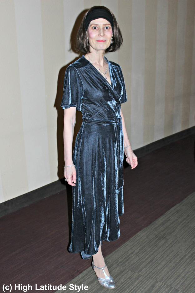 stylist in velvet tea-length wrap dress