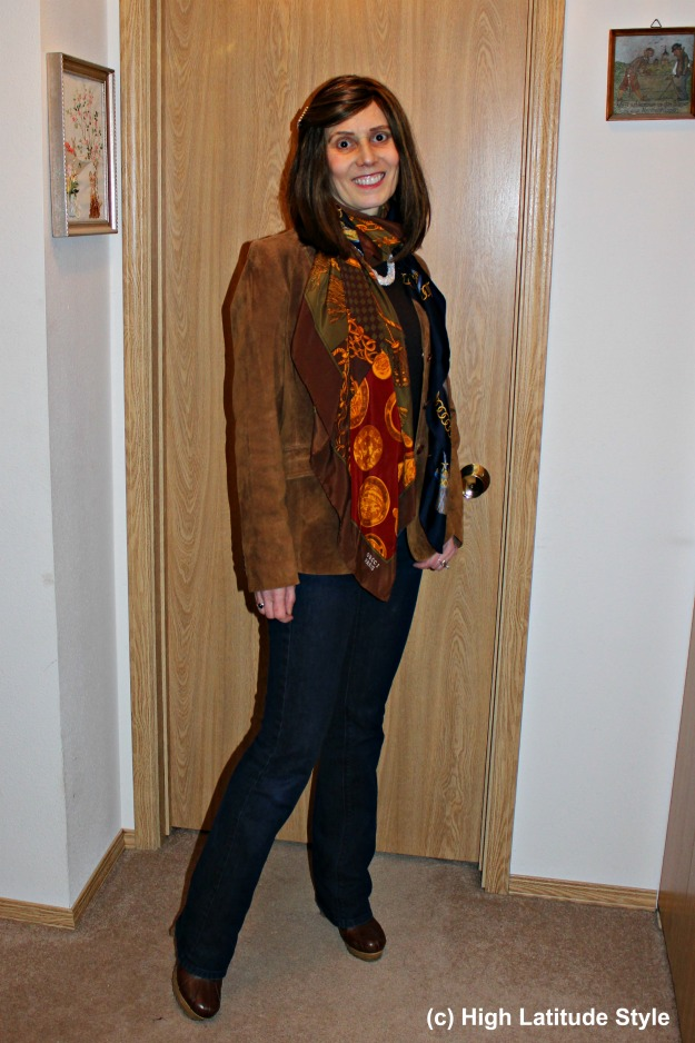 fashion blogger featuring an American West classic shawl outfit with suede blazer, and denim pants