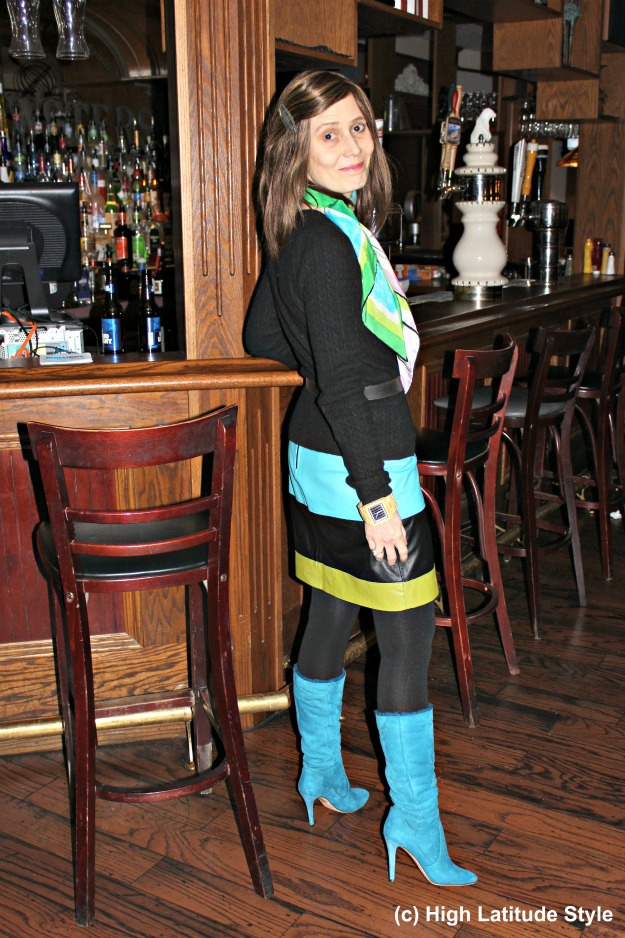 turquoise, greenery, black business casual outfit with scarf, leather skirt, tights and calf high boots