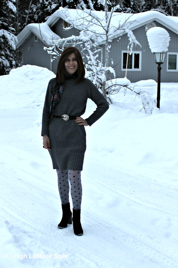 fashion blogger over 50 in sweater dress with booties dress