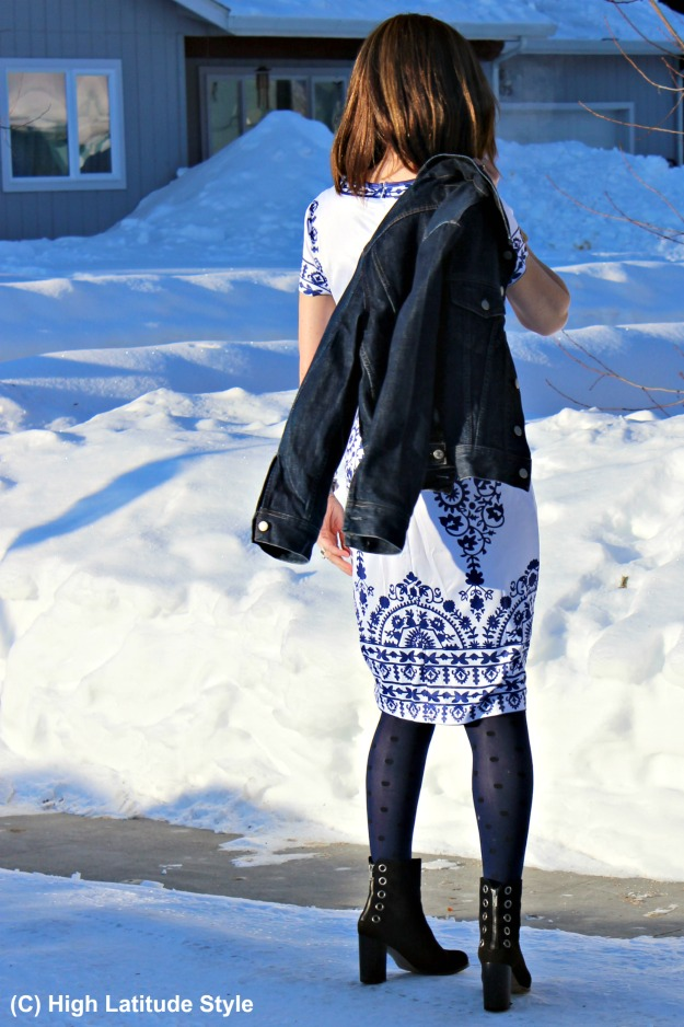 fashion blogger in blue and white printed summer dress styled for spring