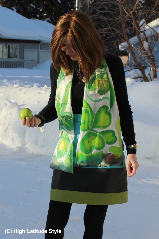 #styleover50 woman wearing an outfit with greenery scarf