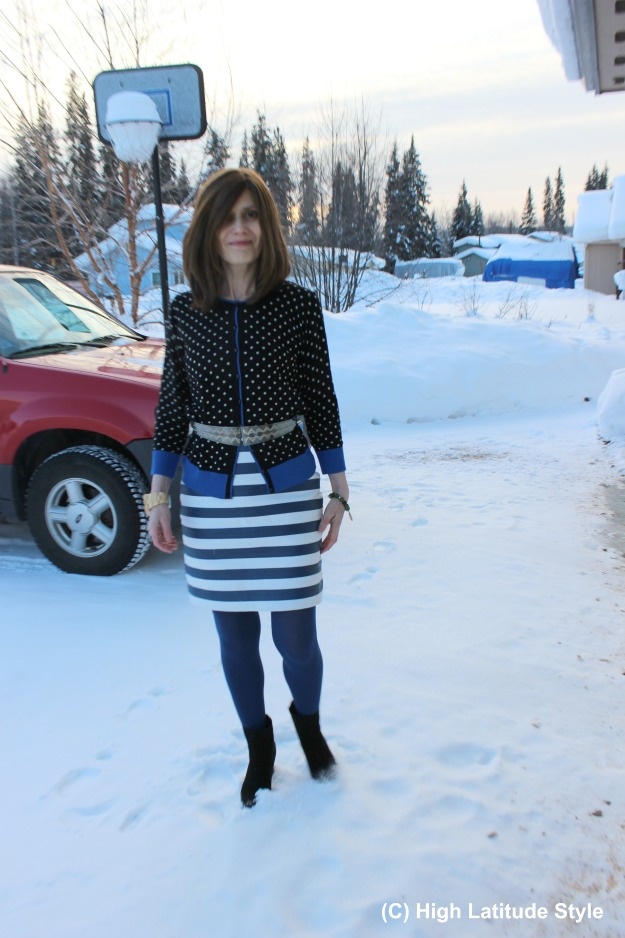 fashionover40 woman in winter work outfit with mixed pattern