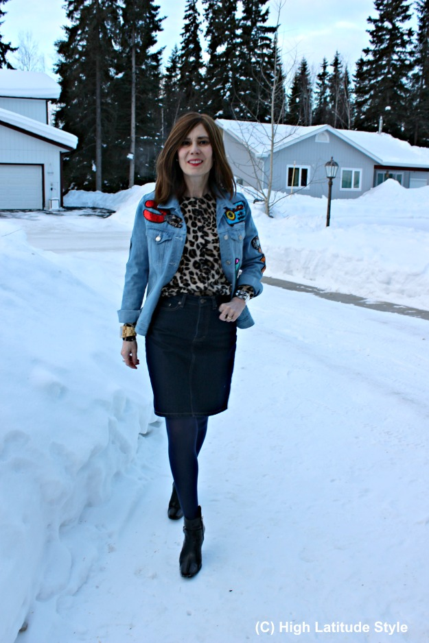 style over 50 woman with leopard print top and light blue jacket