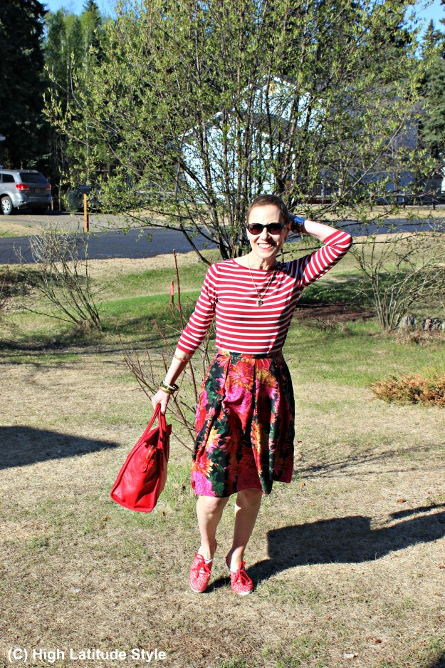 #fashionover40 woman looking posh in floral skirt and striped top
