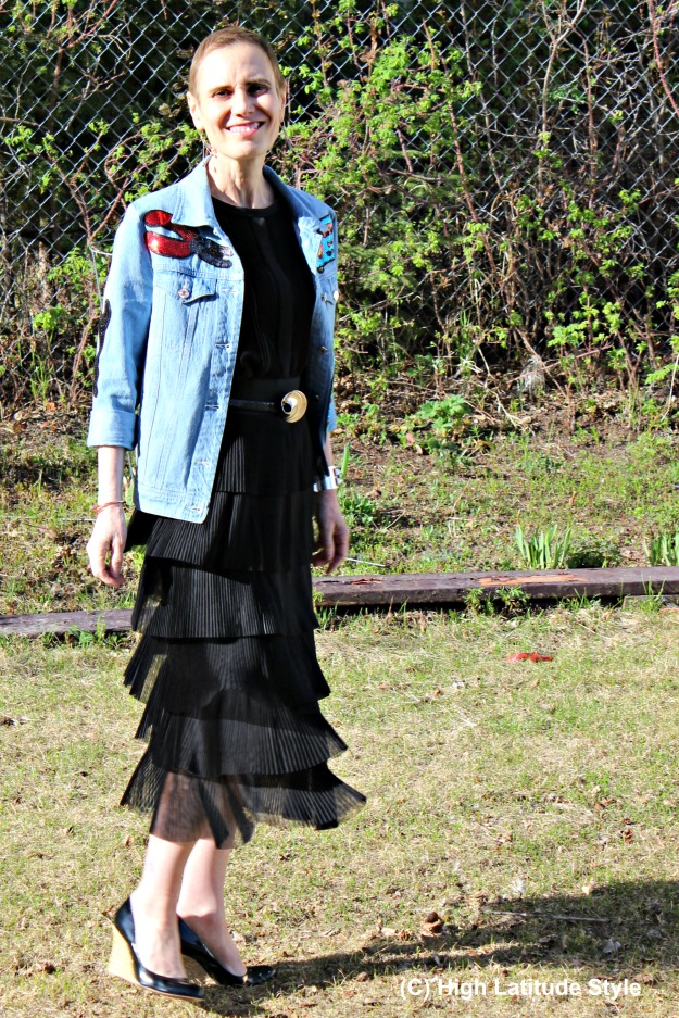 fashion over 40 woman in black with sequin denim jacket