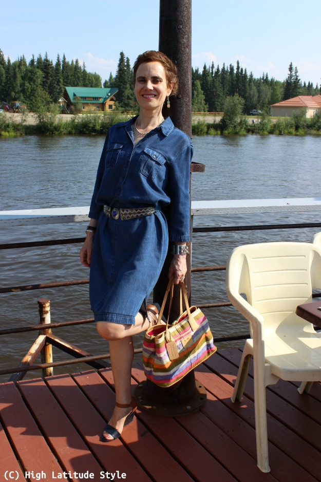#fashionover50 woman in denim dress with sandals and wooden ear pieces