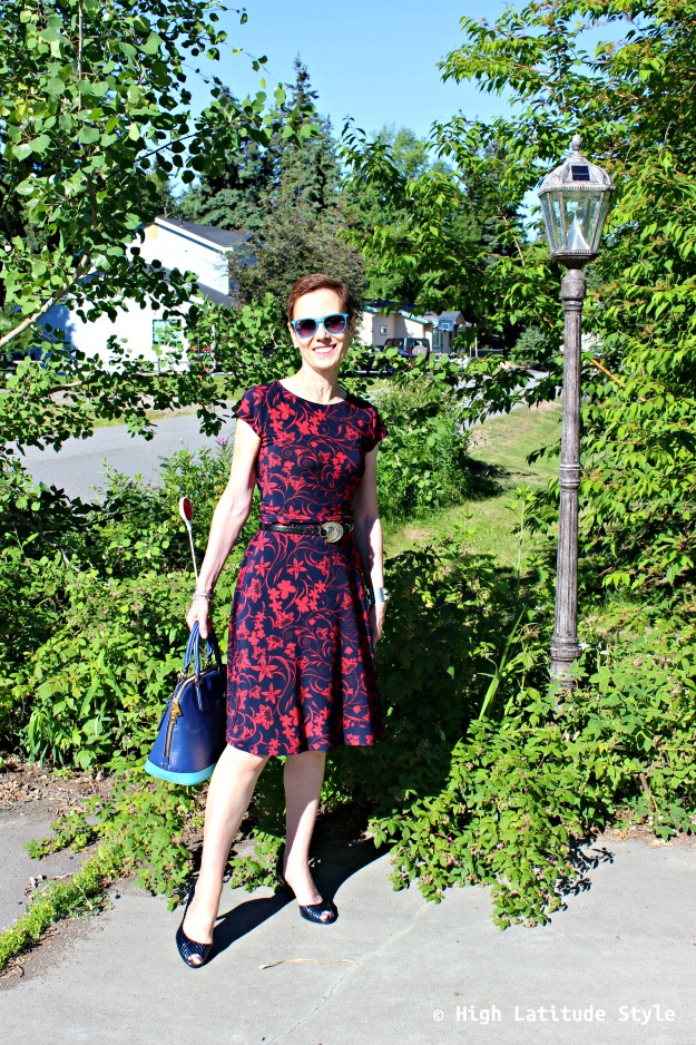 #fashionover40 Alaskan woman in blue with red abstract floral print summer dress