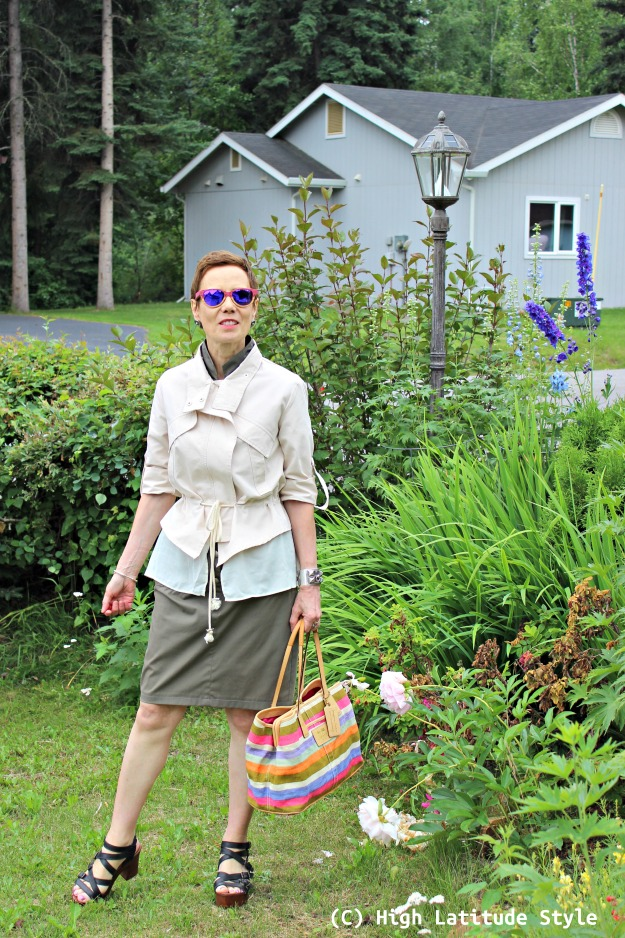 #fashionover50 mature woman in urban casual look with an utility jacket
