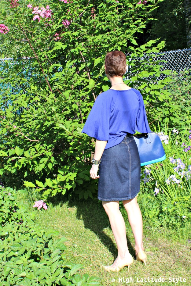 mature woman in posh chic blue skirt and top for July