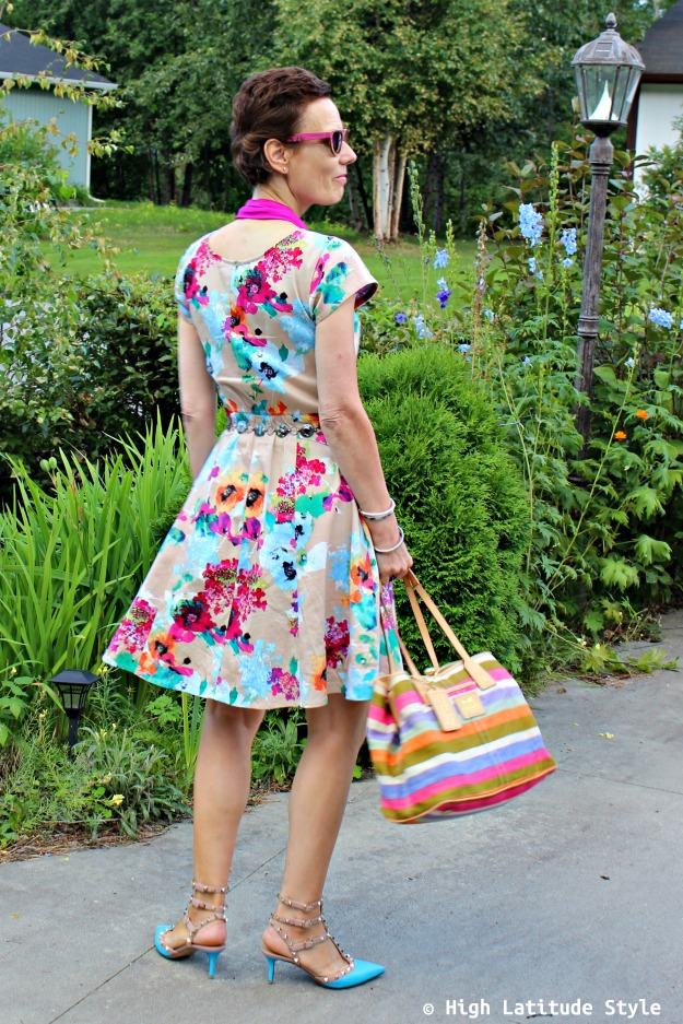 #midlifestyle over 50 year old woman in abstract floral print dress