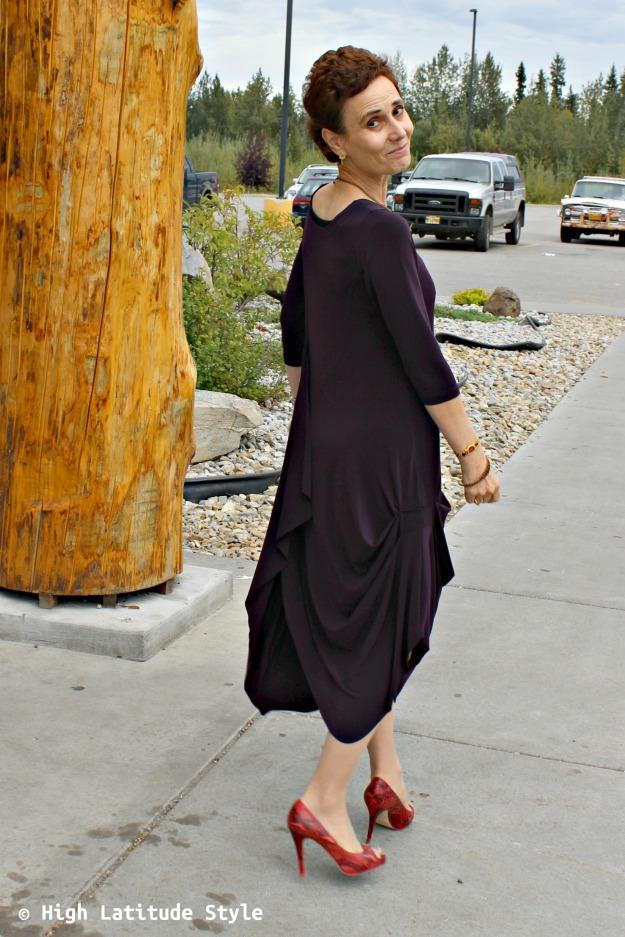 #fashionover50 woman in a dramatic garment