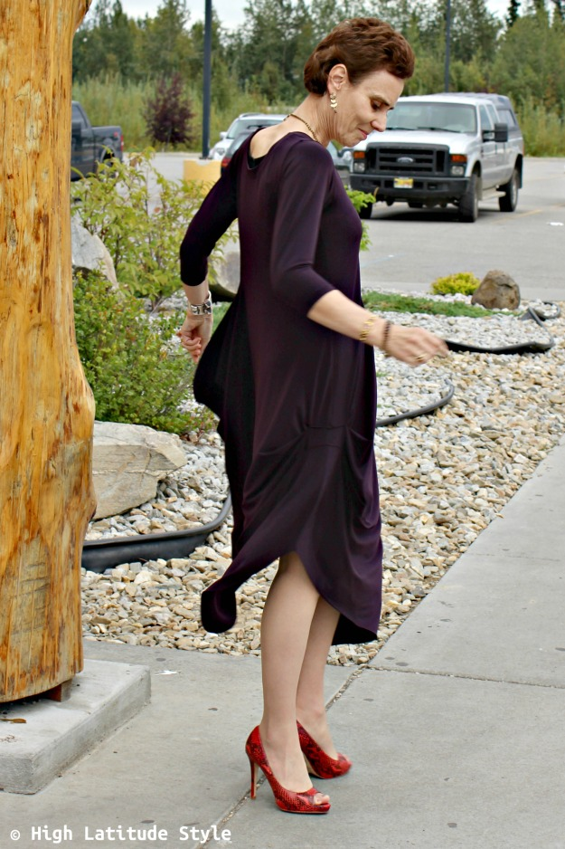 mature style blogger twirling in a dramatic dress