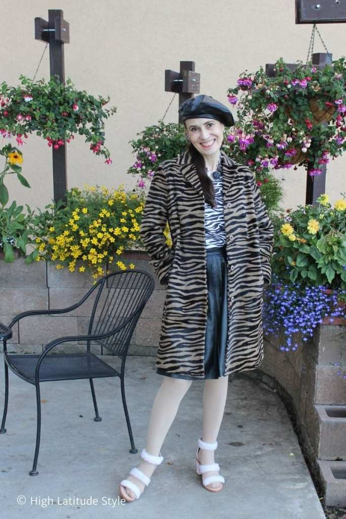 fashion blogger doubling up on zebra animal print with a top and coat