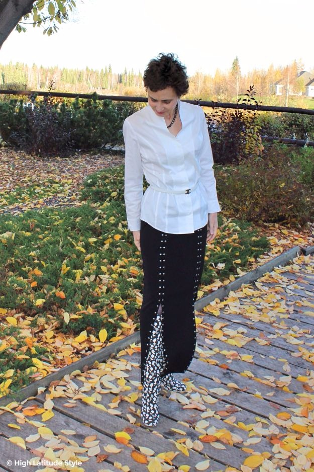 #midlifestyle woman in high collar blouse and boot skirt