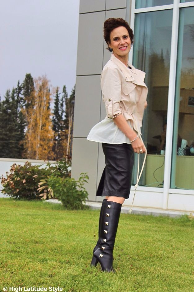 style blogger wearing studded boots with a leather skirt and utility jacket
