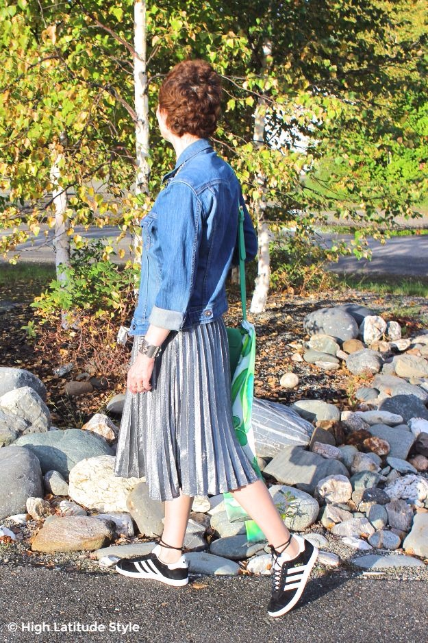 High Latitude Style showing how to wear a pleated skirt in fall with denim jacket and sneakers