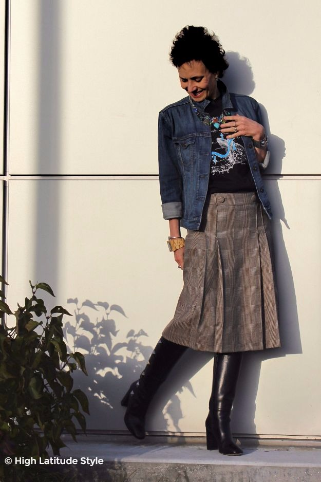 #fashionover40 woman in plaid skirt and Valentino studded boots street chic look