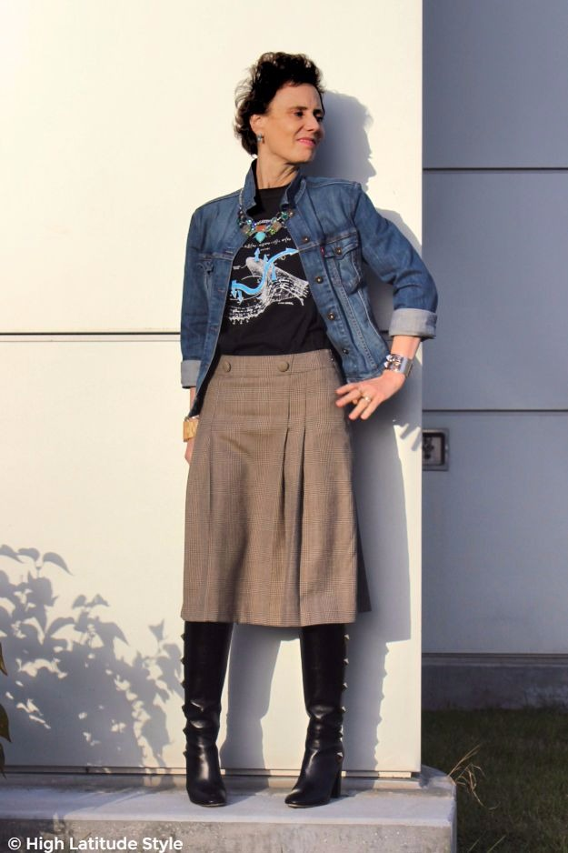 midlife fashion blogger in trendy plaid skirt and denim jacket