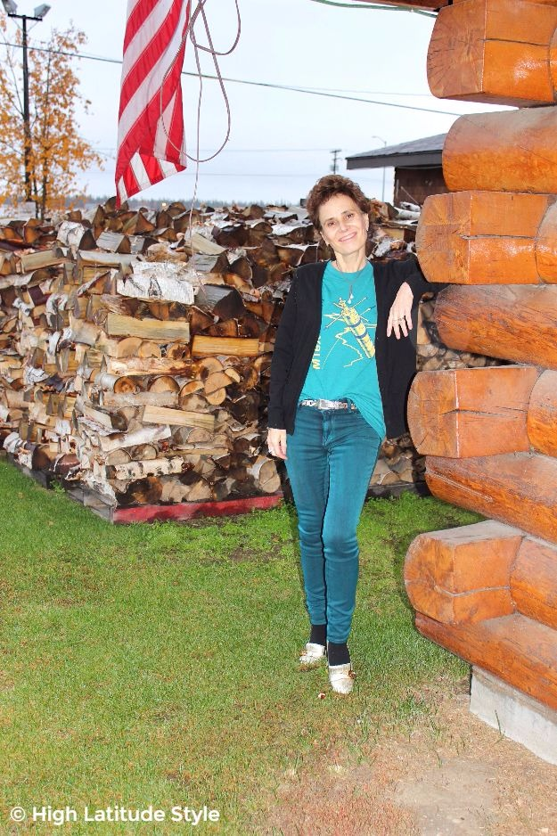 Alaskan in green jeans with graphic T-shirt and cardigan