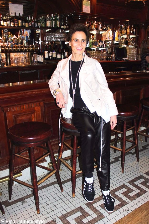 Alaskan woman in desaturated outfit at the saloon