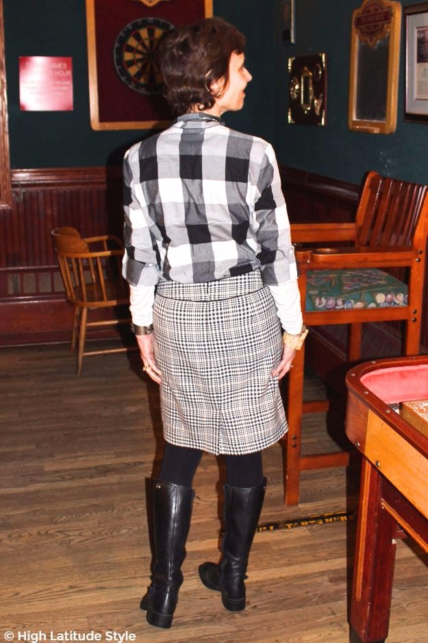 mature woman in hounds tooth skirt, plaid shirt