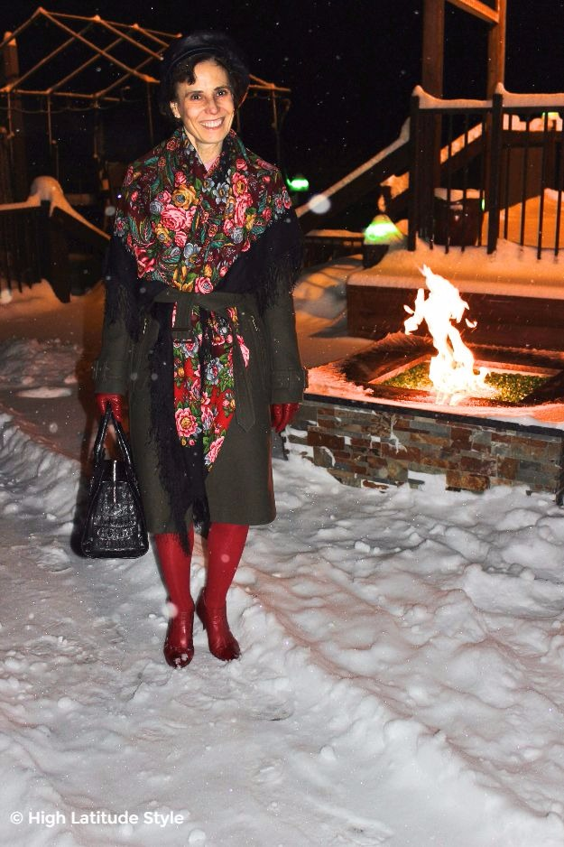 posh chic midlife woman in front of a fire