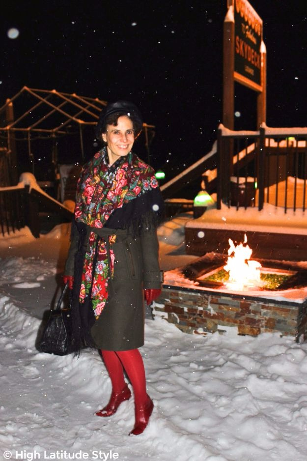 #maturestyle woman in olive coat with Russian scarf, red booties and tights