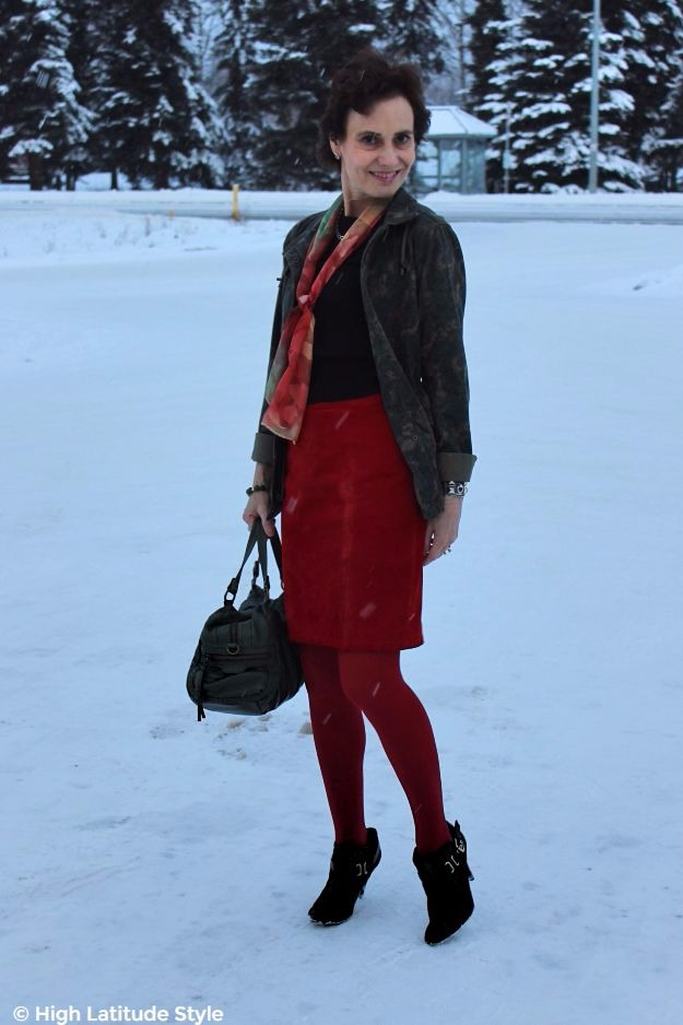 #streetstyle midlife woman in heels on snow in red and olive winter Casual Friday look