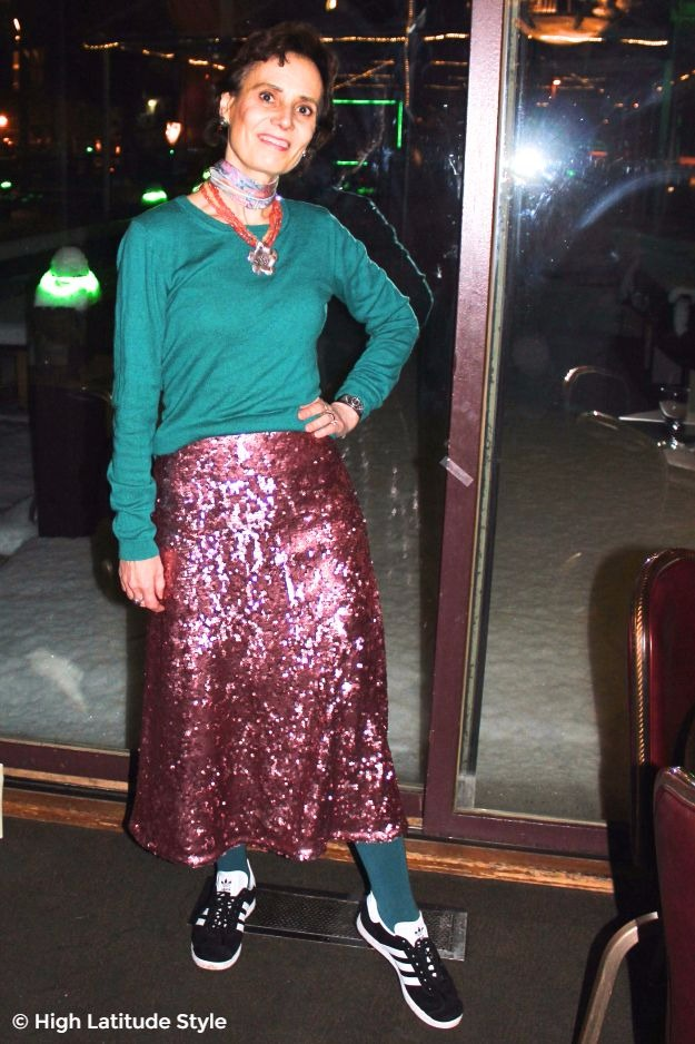 midlife fashion blogger in Alaska street style with sequin skirt and sneakers