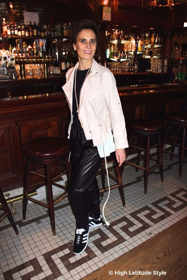 midlife woman in leather joggers and utility jacket
