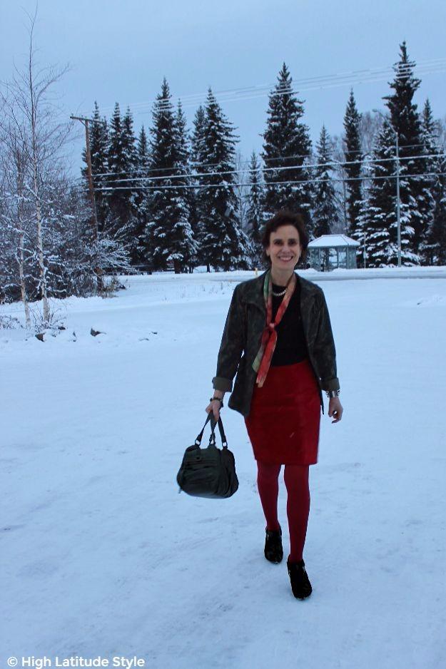 posh chic midlife woman walking on snow