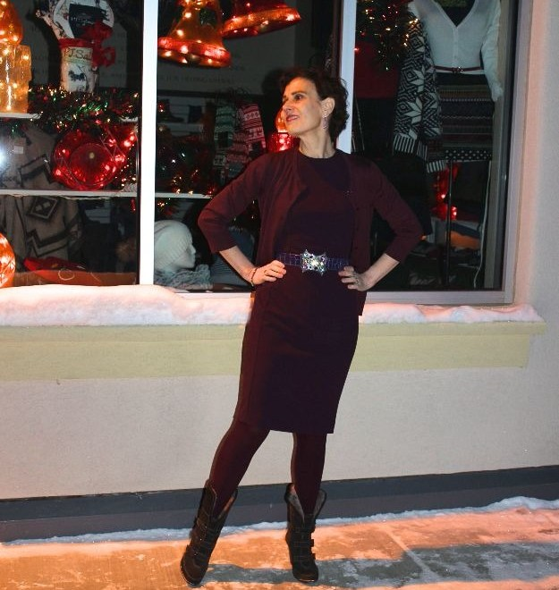 #fashionover40 #fashionover50 woman in Calvin Klein dress in front of a Fairbanks clothing store