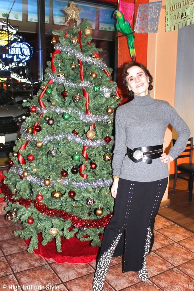 #midlifestyle mature woman looking posh in front of a Christmas tree