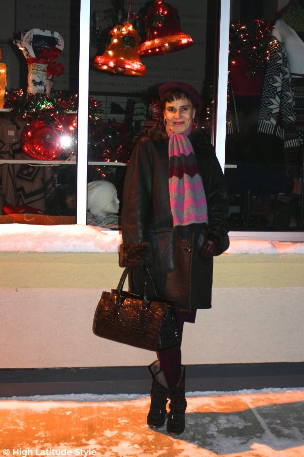 #advancedstyle #midlifestyle woman in posh outerwear in front of an Alaska apparel store
