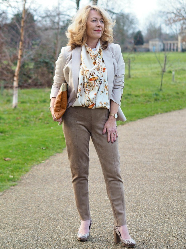 #advancedstyle front view of Laurie's outfit with neutral pants, blazer, shoes scarf and bag in different shades