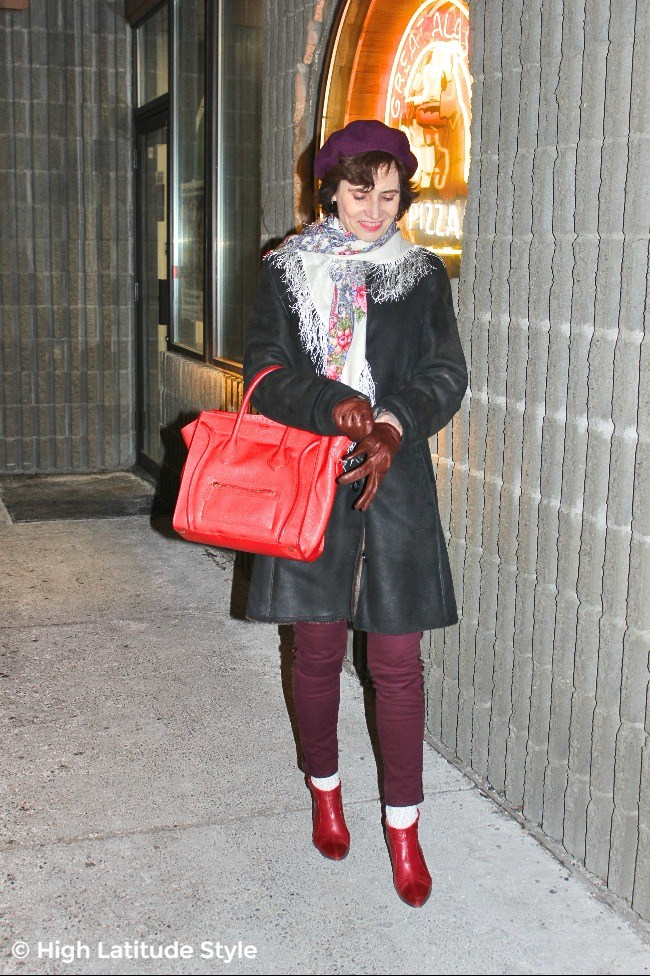 #fashionover50 woman looking posh with gauntlet in winter outfit in a mall