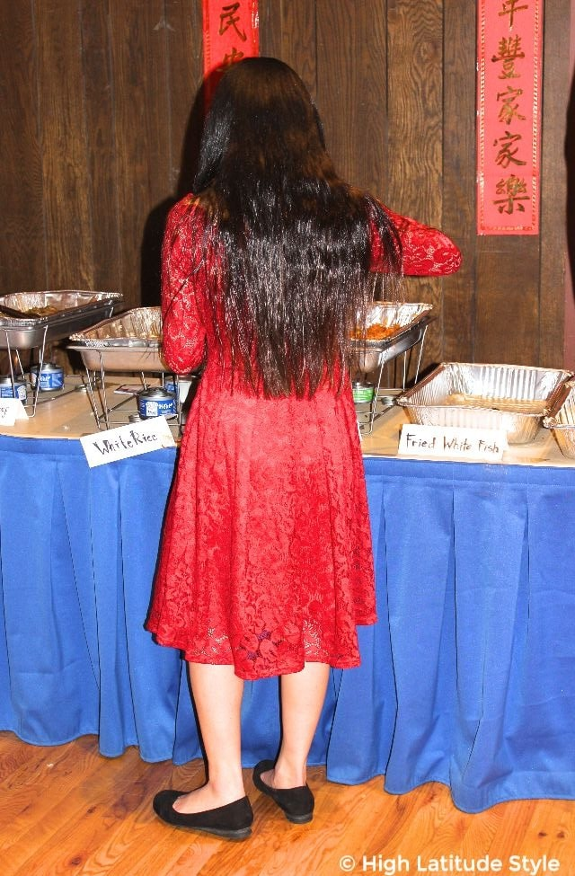 woman wearing a red lace fit-and-flare dress for Chinese New Year