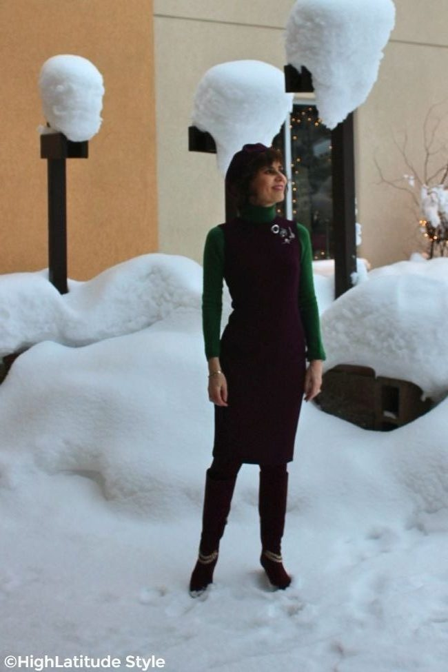 fashion blogger wearing a sheath with several pins instead of a belt over turtleneck with tall boots