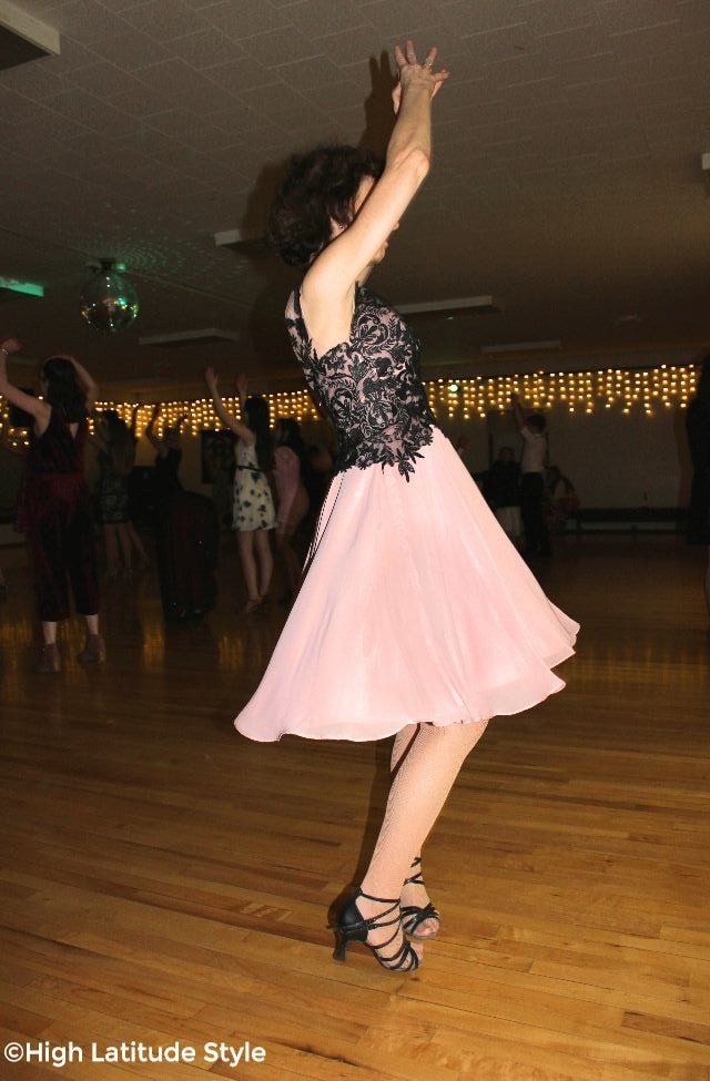 #AdavancedStyle woman in a dress twirling at a social dance