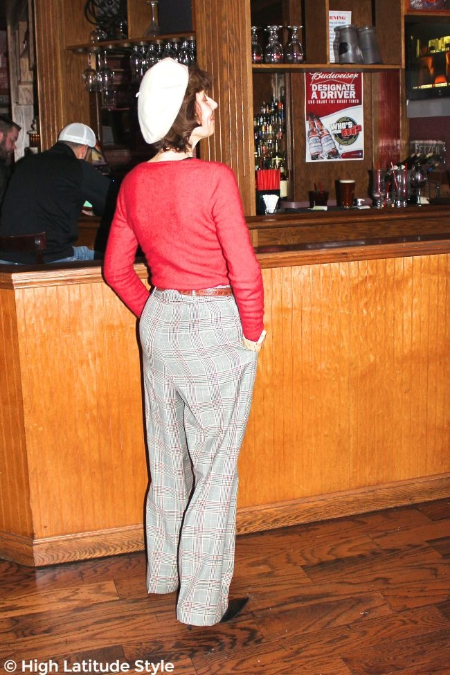stylist looking posh chic in a sweater with high waisted plaid pants look