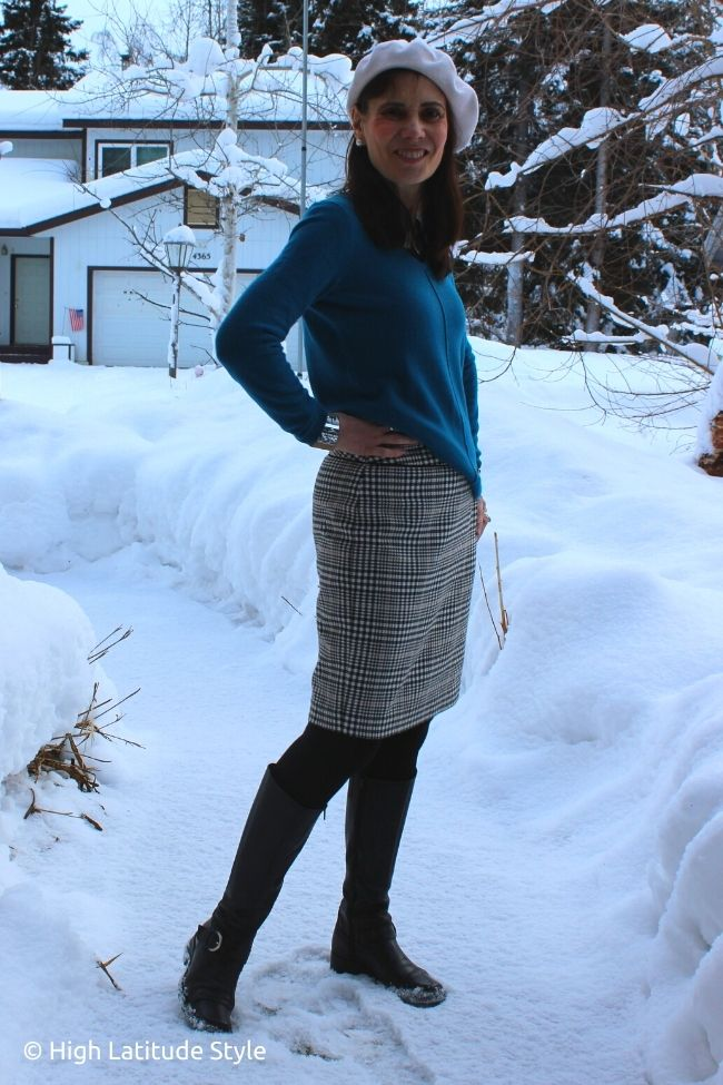 over 50 years old fashion blogger in petrol sweater houndstooth straight above the knee skirt, tights flatt boots