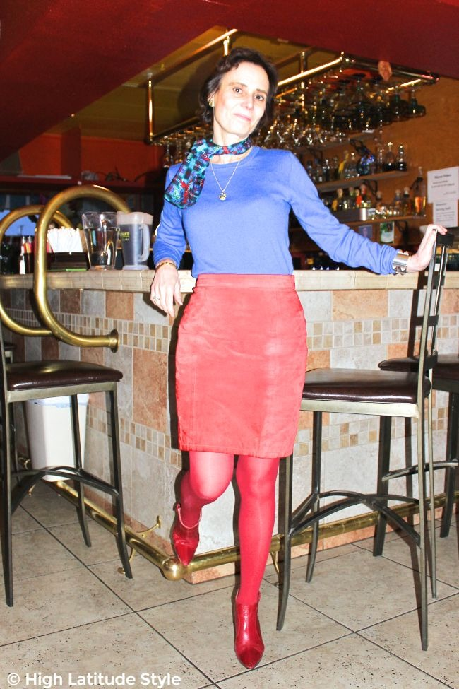 #midlifestyle mature woman in casual work outfit with red skirt and blue sweater