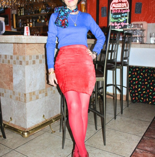 #fashionover50 woman in blue sweater, red suede leather skirt, scarf and tight