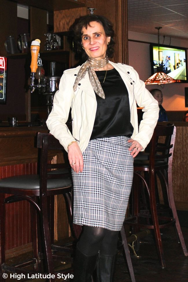 Alaskan stylist in spring with leather jacket, wool skirt and silk top