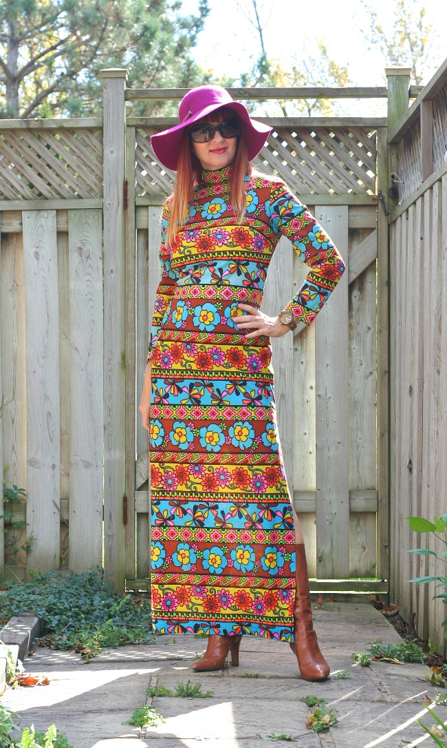 #flowerpower Suzanne Carillo in a sleek maxi dress with flower power print on stripes and hat