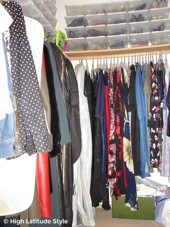 #fashion clothes on hangers and shoes in boxes