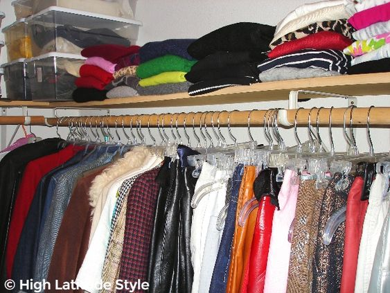 view on sweaters, jackets, skirts and storage boxes on racks and shelves